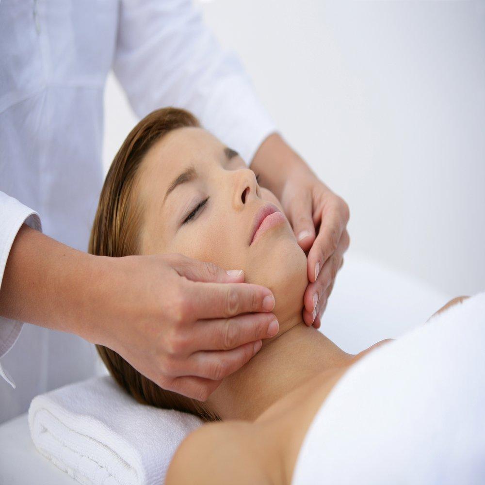 A woman receiving a Natural Lift Face Massage